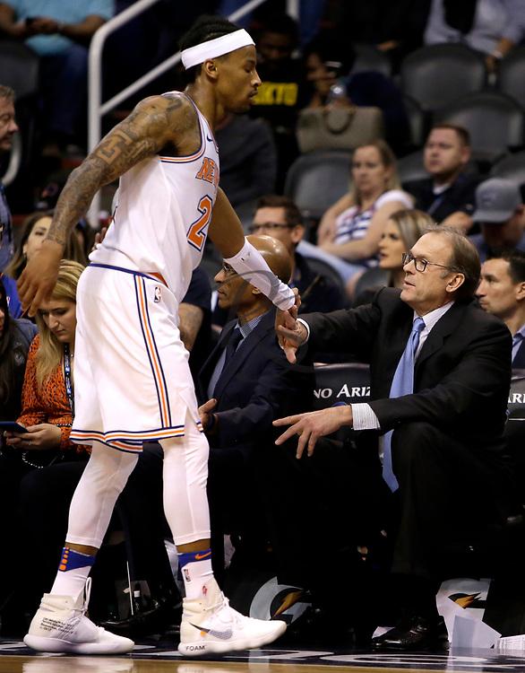 New York Knicks coach Kurt Rambis in the first half during an NBA basketball game against the Phoenix Suns, Friday, Jan. 26, 2018, in Phoenix. (AP Photo/Rick Scuteri)