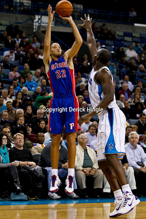 December 8, 2010; New Orleans, LA, USA; Detroit Pistons small forward Tayshaun Prince (22) shoots over New Orleans Hornets center Emeka Okafor (50) during the first half at the New Orleans Arena. Mandatory Credit: Derick E. Hingle