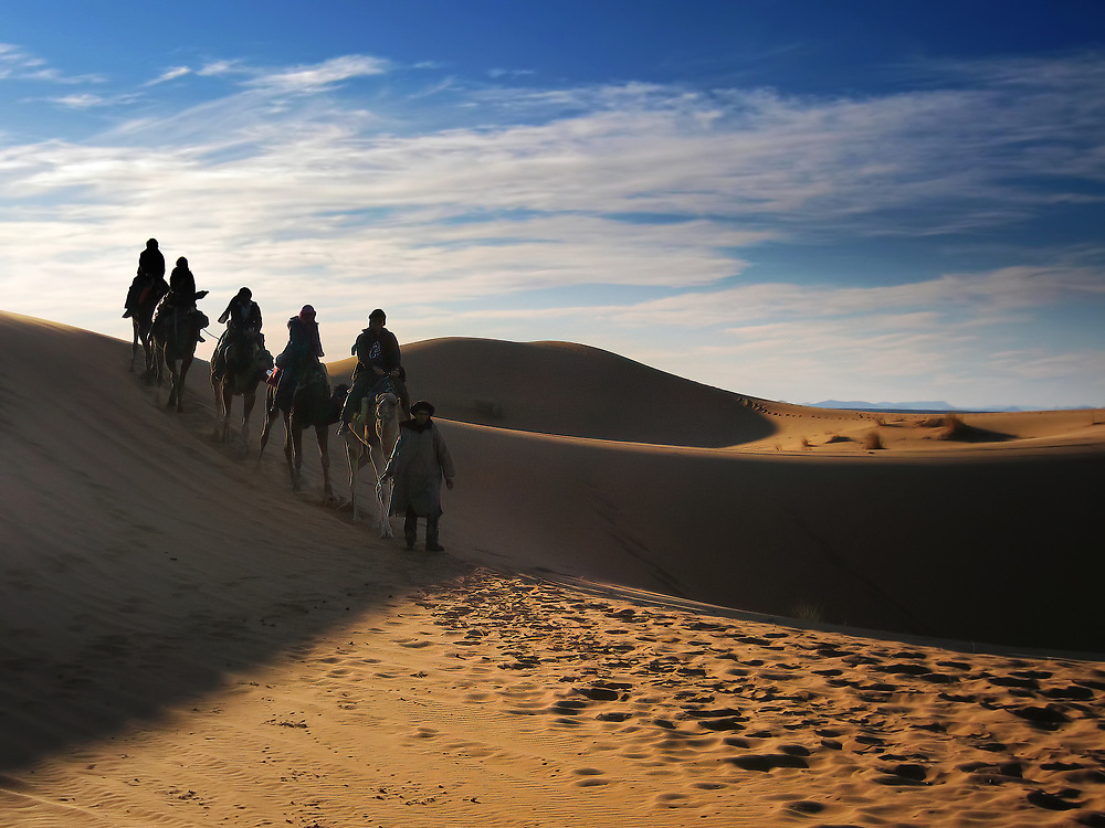 I love the feeling of adventure and journey. The mystery and the questions which this image imparts... just what is over the next sand dune? Where is this group of explorers going on the backs of camels? The silhouettes of the riders lead the viewer from left to right across and down a sand dune and out the side of the image.<br /> <br /> There is &ldquo;Camel Chocolate&rdquo; in them dunes! so my camel guide told me later!... head for the clean sand untrod my man or beast i say!