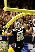 NEW ORLEANS, LA - NOVEMBER 11:  Jimmy Graham #80 of the New Orleans Saints goes up to dunk the football after scoring a touchdown against the Atlanta Falcons at Mercedes-Benz Superdome on November 11, 2012 in New Orleans, Louisiana.  The Saints defeated the Falcons 31-27.  (Photo by Wesley Hitt/Getty Images) *** Local Caption *** Jimmy Graham