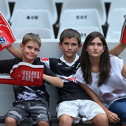 DURBAN, SOUTH AFRICA - MARCH 08: Young Sharks fans  during the Super Rugby match between Cell C Sharks and Lions at Growthpoint Kings Park on March 08, 2014 in Durban, South Africa. (Photo by Steve Haag/Gallo Images)