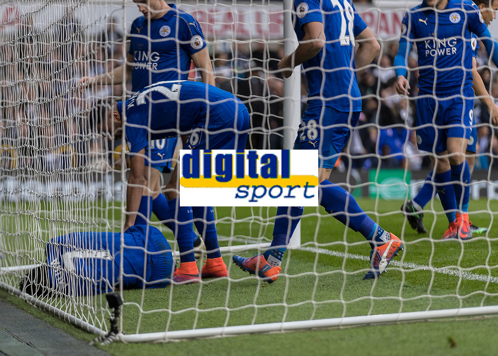 Football - 2016 / 2017 Premier League - Tottenham Hotspur vs. Leicester City<br /> <br /> Worried Leicester players run in to check on goalscorer Shinji Okazaki of Leicester City after he does not move after scoring at White Hart Lane.<br /> <br /> COLORSPORT/DANIEL BEARHAM