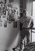 Student standing next to posters in room, Essex University Campus, UK, 1984