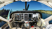 The wide windshield and cockpit of the Cessna 208 Caravan Supervan 900