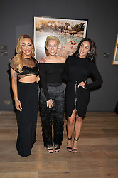 Pop group Stooshe at a private view of photographs in aid of the Sir Hubert von Herkomer Arts Foundation held at Alon Fine Art, 5-7 Dover Street, London on 8th September 2015.