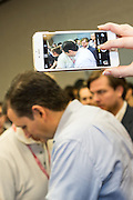 A supporter of Senator Ted Cruz takes a camera phone photo as he greets fans at the South Carolina Tea Party Coalition convention on January 18, 2015 in Myrtle Beach, South Carolina. A variety of conservative presidential hopefuls spoke at the gathering on the third day of a three day event.