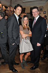 Left to right, DOUG KERR, his wife MELISSA DEL BONO and EWAN VENTERS, chief executive, Fortnum & Masonat an afternoon tea party in aid of the Naked Heart Foundation held at Mari Vanna, Wellington Court, 116 Knightsbridge, London on 29th August 2012.