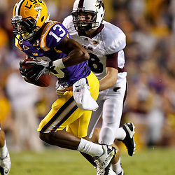 November 13, 2010; Baton Rouge, LA, USA; LSU Tigers cornerback Ron Brooks (13) returns an interception for a touchdown against the Louisiana Monroe Warhawks during the first half at Tiger Stadium.  Mandatory Credit: Derick E. Hingle