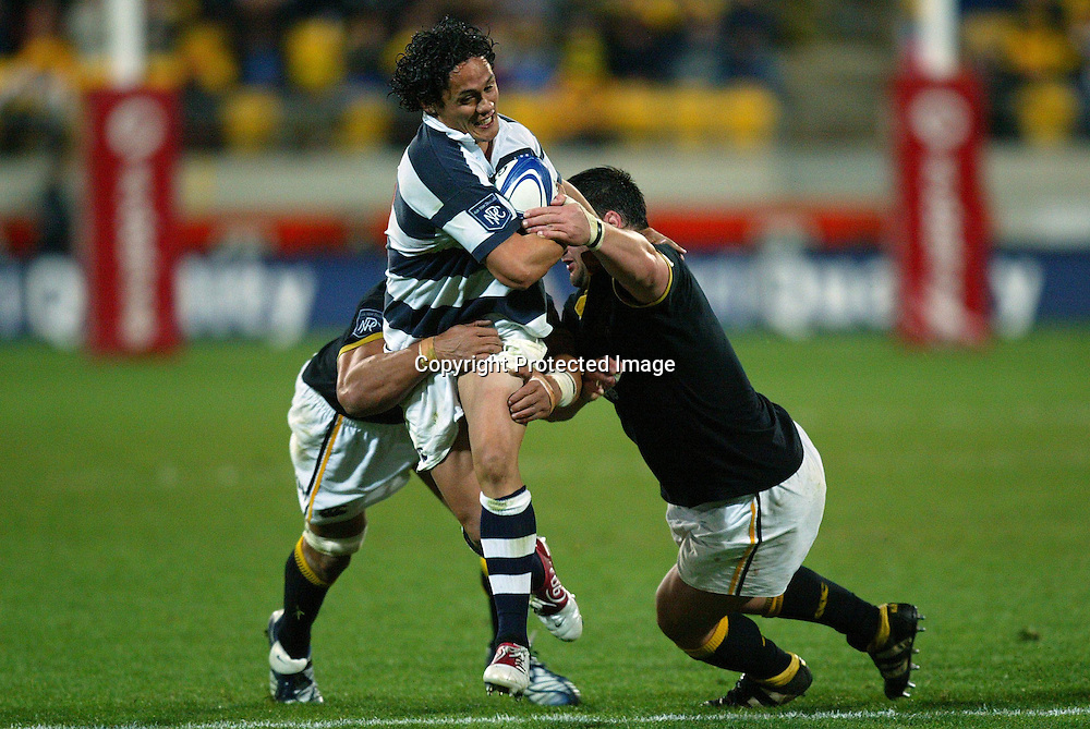 Auckland's Tasesa Lavea gets tackled by Lion's Jerry Collins and Jow McDonnell during the Wellington Lions 27-21 win over Auckland on Saturday night at the Westpac Stadium, Wellington, New Zealand. NPC Div 1 <br /> 11 September 2004<br /> Photo: Marty Melville/Photosport