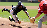 CHICAGO - JULY 08:  Juan Pierre #1 of the Chicago White Sox slides safely into third base in the first inning against the Los Angeles Angels of Anaheim on July 8, 2010 at U.S. Cellular Field in Chicago, Illinois.  Pierre eventally scored the only run of the game on a sacrifice fly hit by Paul Konerko #14 of the Chicago White Sox.  The White Sox defeated the Angels 1-0.  (Photo by Ron Vesely)