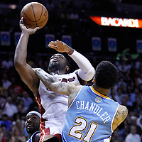 19 March 2011: Miami Heat shooting guard Dwyane Wade (3) is fouled by Denver Nuggets small forward Wilson Chandler (21) during the Miami Heat 103-98 victory over the Denver Nuggets at the AmericanAirlines Arena, Miami, Florida, USA.
