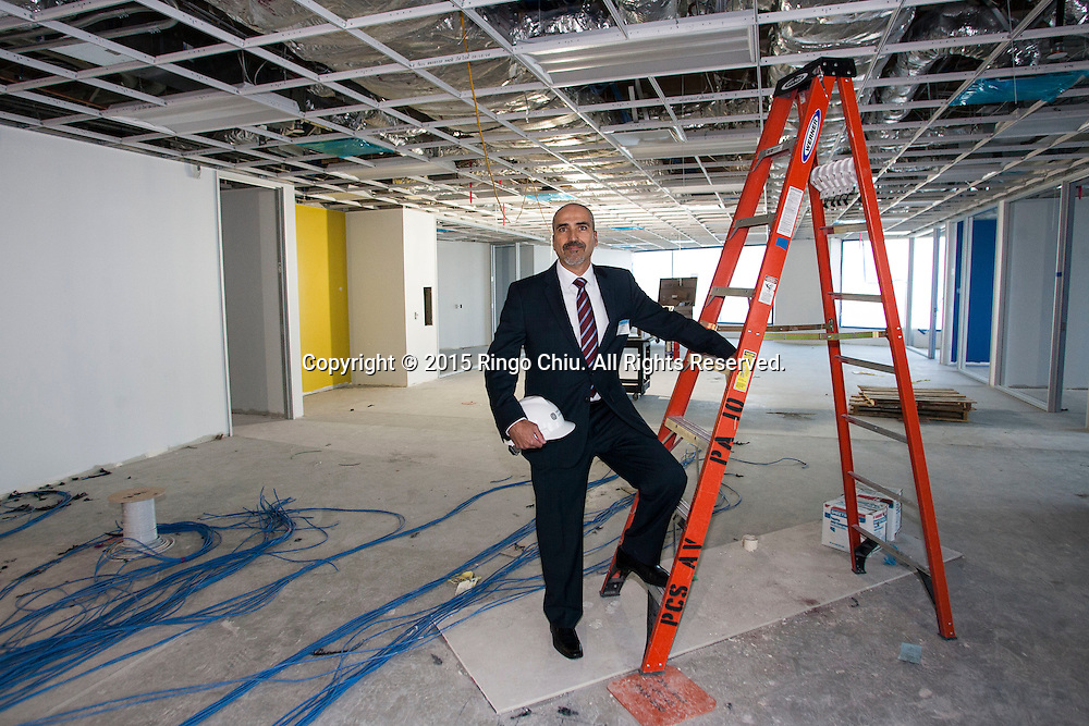 Phil Friedl of Jones Lang LaSalle in front of a production studio that is currently under construction. (Photo by Ringo Chiu/PHOTOFORMULA.com)