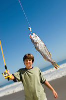 Boy Showing off Fish