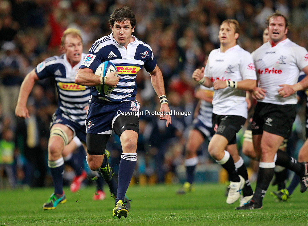 Stormers centre Jaque Fourie (2-L) on his way to score a try during the Super Rugby match against the Sharks in Cape Town, South Africa 30 April 2011