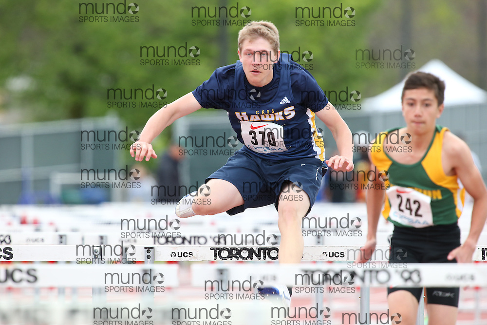 Felix Marchand of Chatham-Kent SS - Chatham competes in the sprint hurdle heats at the 2013 OFSAA Track and Field Championship in Oshawa Ontario, Thursday,  June 6, 2013.<br /> Mundo Sport Images / Sean Burges