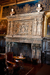 Sitting area with ornate fireplace, Hearst Castle, San Simeon, California, United States of America
