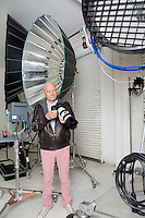 Senior photographer with camera and equipments in studio