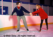 Exercise, Young Adult Husband and Wife Lovingly Ice Skate at Indoor Rink, Mechanicsburg, Cumberland Co., PA