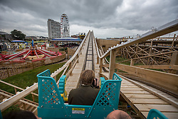 @Licensed to London News Pictures 15/10/15. Margate, Kent. Members of the Press, employees and prize winners ride the Dreamland Margate's Scenic Railway and Britains original roller coaster as it re-opens today 15/10/15. The restoration and final opening of the Scenic Railway marks the completion of the Dreamland Amusement Park largely supported by a grant of almost £6m form the Heritage Lottery Fund. Photo credit: Manu Palomeque/LNP