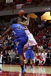 31 December 2014: Will Ransom gets hammered by TJ Bell as he sails up for a shot during an NCAA Division 1 Missouri Valley Conference (MVC) men's basketball game between the Indiana State Sycamores beat the Illinois State Redbirds 63-61 at Redbird Arena in Normal Illinois
