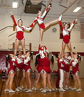The Laconia High School Cheerleaders lift Gabi Mooney, Gillian Gorse and Katie Gorman for the pyramid during their half time routine at the boys varsity basketball game Tuesday evening.  (Karen Bobotas/for the Laconia Daily Sun)