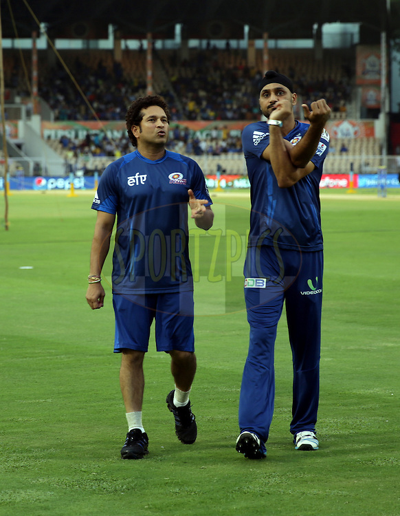 Sachin Tendulkar Mentor of Mumbai Indians and Harbhajan Singh of the Mumbai Indians before the eliminator match of the Pepsi Indian Premier League Season 2014 between the Chennai Superkings and the Mumbai Indians held at the Brabourne Stadium, Mumbai, India on the 28th May  2014<br /> <br /> Photo by Sandeep Shetty / IPL / SPORTZPICS<br /> <br /> <br /> <br /> Image use subject to terms and conditions which can be found here:  http://sportzpics.photoshelter.com/gallery/Pepsi-IPL-Image-terms-and-conditions/G00004VW1IVJ.gB0/C0000TScjhBM6ikg