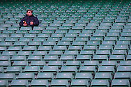 6 Feb 2010 Twickenham, England: A lone spectator eats a chocolate bar before the start of the Six Nations match between England and Wales. Photo © Andrew Tobin www.slikimages.com