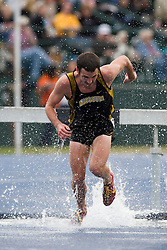 Tim Cornell of Missouri splashes into the water hazard in the men's 3000m steeplechase.  The Virginia Cavaliers men's and women's track and field teams hosted the Missouri Tigers.  The Virginia women defeated Missouri while the Mizzou men defeated UVA on April 5, 2008 at The University of Virginia's Lannigan Field in Charlottesville, VA.