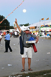 03 May 2015. New Orleans, Louisiana.<br /> The New Orleans Jazz and Heritage Festival. <br /> Man and the moon.<br /> Photo; Charlie Varley/varleypix.com