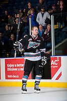 KELOWNA, CANADA - DECEMBER 2: Rourke Chartier #14 of Kelowna Rockets enters the ice to accept the first star of the game after scoring a hat trick against the Kootenay Ice on December 2, 2015 at Prospera Place in Kelowna, British Columbia, Canada.  (Photo by Marissa Baecker/Shoot the Breeze)  *** Local Caption *** Rourke Chartier;