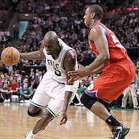 14 May 2012: Boston Celtics power forward Kevin Garnett (5) drives past Boston Celtics center Ryan Hollins (50) during the Philadelphia Sixers 82-81 victory over the Boston Celtics, in Game 2 of the Eastern Conference semifinals playoff series, at the TD Banknorth Garden, Boston, Massachusetts, USA.