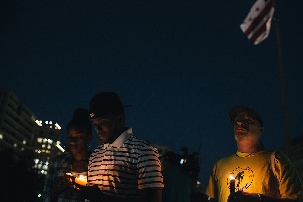 WASHINGTON, DC - SEPTEMBER 16:  Brittany Carter, of Bowie, MD., left, Jibri Johnson, of Landon, MD. center, and Bryan Beard of Washington D.C. hold candles in remembrance of people affected by gun violence during a vigil at Freedom Plaza in Washington, D.C. on Sept. 16, 2013. The vigil, during which organizers called for stricter gun laws, was in remembrance of the more than 10 killed in a shooting at the Navy Yard earlier in the day.   (Photo by Greg Kahn/Getty Images)