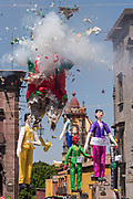 A paper doll effigy explodes during the Burning of Judas Easter-time ritual marking the end of Holy Week in the Plaza Allende April 1, 2018 in San Miguel de Allende, Mexico.