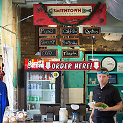 Smithtown Seafood in Lexington, Ky., Friday, December 11, 2015. The Bread Box houses a number of businesses, including West Sixth Brewing and FoodChain, which grows the tilapia. Waste from fish grown in tanks is used to feed greens and the filtered water is looped back into the fish tanks. The fish and greens are sold and used at Smithton Seafood located in the same building, an old Rainbo Bread factory. (Photo by David Stephenson)