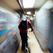 Rex Flake coasts his bike down the hall of lockers at Steven's Pass Resort near Leavenworth, Washington.