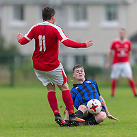 Newmarket Celtic's Ian Collins  is tackled by Bridge United's Brandon O'Halloran