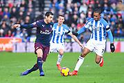 Juninho Bacuna of Huddersfield Town (7) pressures Henrikh Mkhitaryan of Arsenal (7) during the Premier League match between Huddersfield Town and Arsenal at the John Smiths Stadium, Huddersfield, England on 9 February 2019.