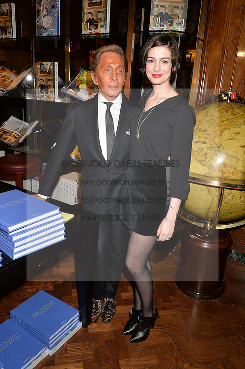 Designer VALENTINO GARAVANI and actress ANNE HATHAWAY at a party to celebrate the launch of the Maison Assouline Flagship Store at 196a Piccadilly, London on 28th October 2014.  During the evening Valentino signed copies of his new book - At The Emperor's Table.
