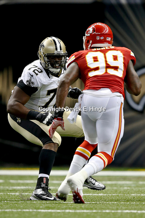 Aug 9, 2013; New Orleans, LA, USA; New Orleans Saints offensive tackle Terron Armstead (72) works against Kansas City Chiefs linebacker Edgar Jones (99) during a preseason game at the Mercedes-Benz Superdome. The Saints defeated the Chiefs 17-13. Mandatory Credit: Derick E. Hingle-USA TODAY Sports