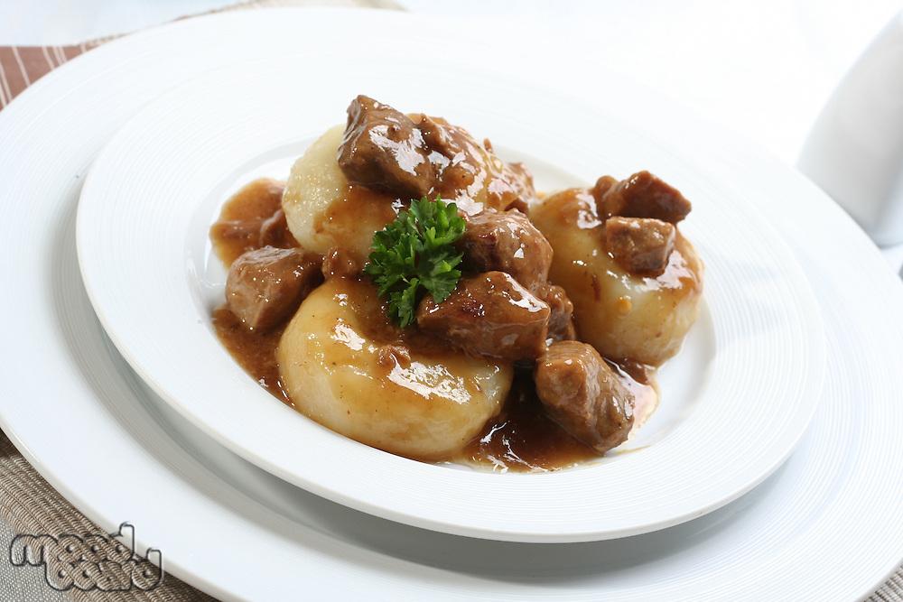 Silesian dumplings on white plate