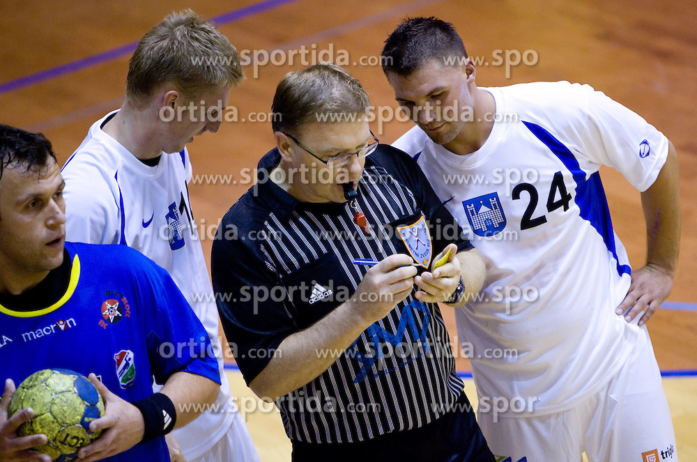 Referee and Bostjan Spegel and Blaz Klec of Prevent at the handball match between RD Ribnica Riko-hise and RK Prevent of MIK 1st League 2009 - 2010,  on October 04, 2009, in Ribnica, Slovenia.   (Photo by Vid Ponikvar / Sportida)