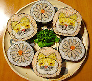 "Tokyo Chef Makes Art With Sushi Rolls <br /> <br /> Tokyo-based sushi chef Tama-chan creates works of art with rolls of sushi. By arranging the rice (which is often colored) and other ingredients inside the seaweed exterior, he is able to create images which are exposed when he slices the roll. He has re-created famous works of art like Edvard Munch's ""The Scream"" and other fun things like cats, flowers, skulls, and, even a baby in the womb. <br /> ©Exclusivepix Media"