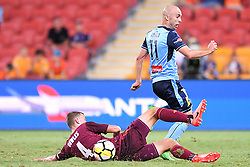 January 8, 2018 - Brisbane, QUEENSLAND, AUSTRALIA - Adrian Mierzejewski of Sydney (11, right) is tackled by Daniel Bowles of the Roar (4) during the round fifteen Hyundai A-League match between the Brisbane Roar and Sydney FC at Suncorp Stadium on Monday, January 8, 2018 in Brisbane, Australia. (Credit Image: © Albert Perez via ZUMA Wire)