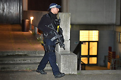 © Licensed to London News Pictures. 28/03/2019. London, UK. Armed police inside The grounds of the mosque, at the scene near Cunningham Place in London NW8 after a man was stabbed to death. Armed police have been seen in the vicinity of nearby Regents Park Mosque as they look for suspects. Photo credit: Ben Cawthra/LNP