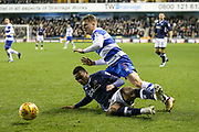 Mahlon Romeo of Millwall and Jake Bidwell of Queens Park Rangers race for the ball during the EFL Sky Bet Championship match between Millwall and Queens Park Rangers at The Den, London, England on 29 December 2017. Photo by Toyin Oshodi.