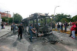 May 24, 2017 - Valencia, Carabobo, Venezuela - A transcarabobo public transport unit was burned last night when being kidnapped by hooded men in the Isabelica. The hooded were against the government of Nicolas Maduro, in Valencia, Carabobo state. Photo: Juan Carlos Hernandez (Credit Image: © Juan Carlos Hernandez via ZUMA Wire)