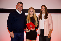 NEWPORT, WALES - Saturday, May 19, 2018: Zoe Collyer is presented with her Under-16's cap by Osian Roberts (left) and Lauren Dykes (right) during the Football Association of Wales Under-16's Caps Presentation at the Celtic Manor Resort. (Pic by David Rawcliffe/Propaganda)