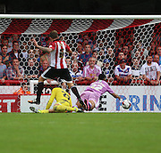 Nick Blackman (Reading striker) getting fouled for a penalty during the Sky Bet Championship match between Brentford and Reading at Griffin Park, London, England on 29 August 2015. Photo by Matthew Redman.
