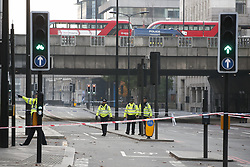 © Licensed to London News Pictures. 30/11/2019. London, UK. Police guard Upper Thames where it passes under London Bridge the day after a terrorist attack. Two people were killed and three injured after the attacker, named by police as 28-year-old Usman Khan stabbed a man and a woman to death on London Bridge. Photo credit: Peter Macdiarmid/LNP