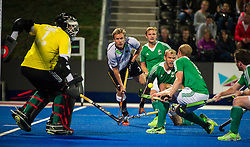 Germany's Linus Butt crosses the ball across the Irish defence. Ireland v Germany - Unibet EuroHockey Championships, Lee Valley Hockey & Tennis Centre, London, UK on 23 August 2015. Photo: Simon Parker